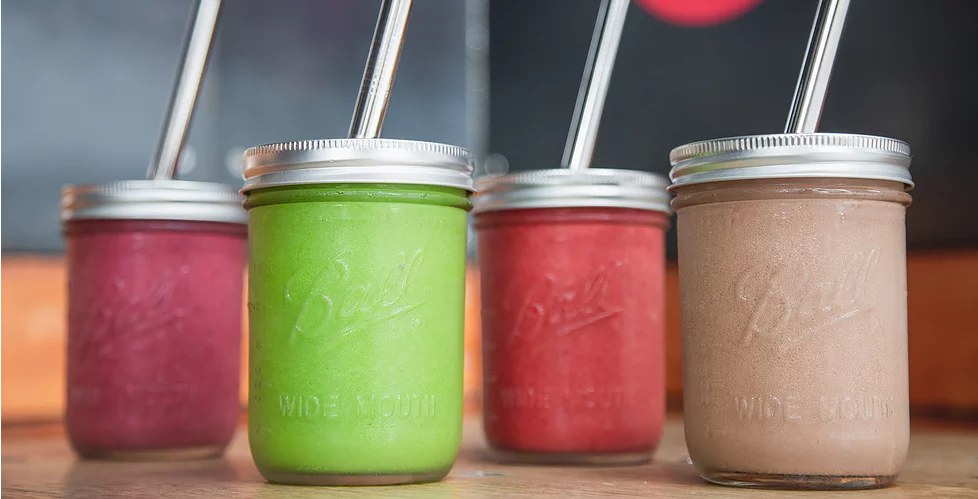 Our super food smoothies served in FREE reusable Ball mason jars with stainless steel straws